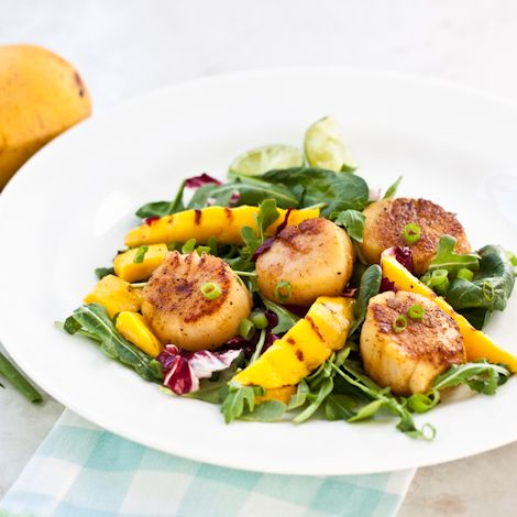 Scallop Salad with Lime and Grilled Mango - Sear some super-fresh sea scallops briefly on the grill along with some mango, and drizzled it all with a sweet-tart lime dressing – this is a great summer dinner.