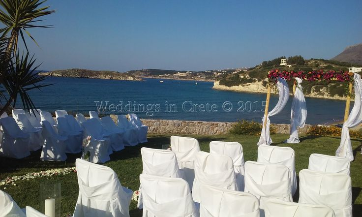 Weddings in Crete - Ceremony on a beautiful lawn with the sea behind.  Chania area