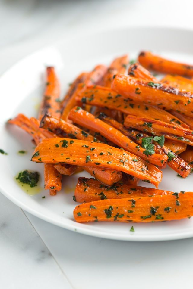 Simple roasted carrots recipe with a garlicky parsley butter. The carrots are sweet, tender and completely delicious. From inspiredtaste.net | @inspiredtaste