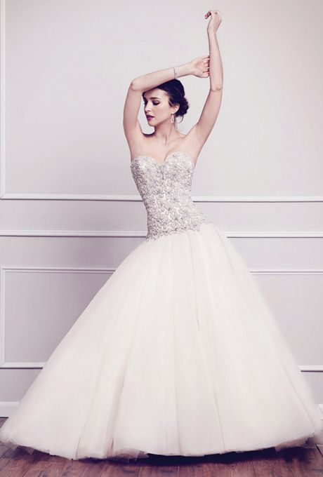 Brides: Kenneth Winston. Swarovski encrusted bodice in floral pattern with over 30,000 hand sewn crystals and beads. Finished with a full volume English net skirt. Zipper back.See More Kenneth Winston Gowns