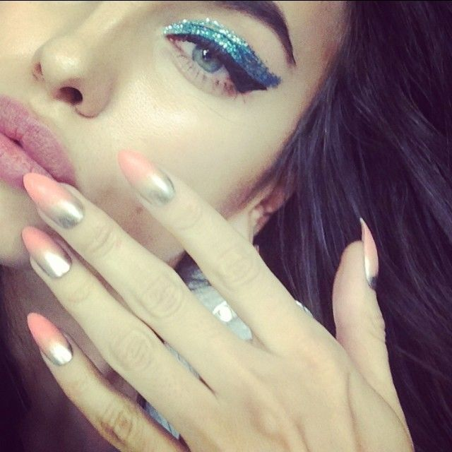 Irina Shayk sports blue eyeshadow and manicured nails in this Instagram photo