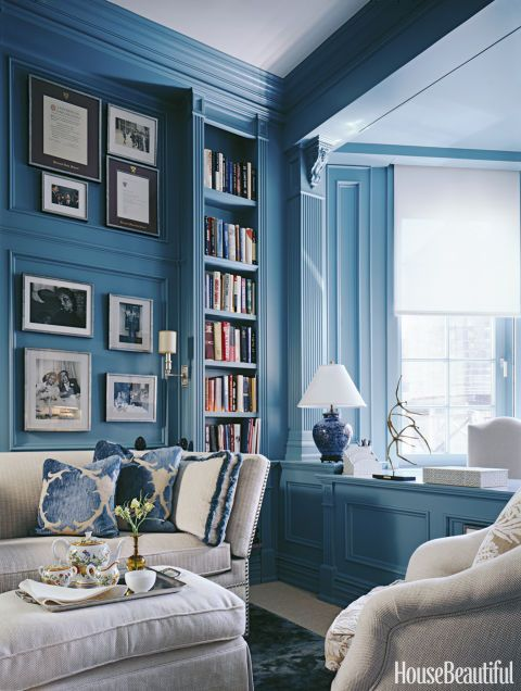 Kristin Hein used this peacock-blue paint to cover up outdated millwork — and create natural borders for small gallery pockets of black-and-white photography.  Read more on HouseBeautiful.com: Here's What $500K Buys You Across the Country