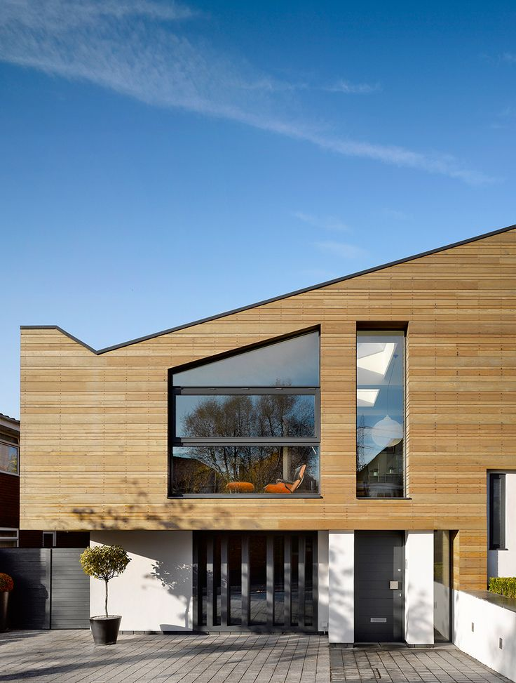 Wooden Exterior Modern and Warm Home With External Cladding by Stephenson ISA Studio
