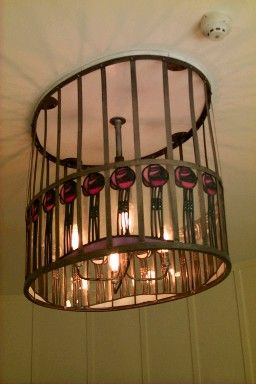 Charles Rennie Mackintosh light fixture, the movement captured in his work can be seen as well as felt