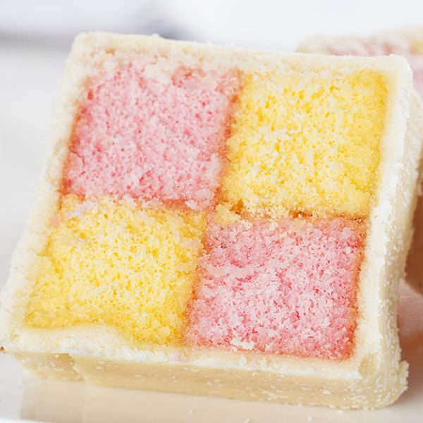 A colorful light sponge cake covered with marzipan.. Battenberg Cake Recipe from Grandmothers Kitchen.