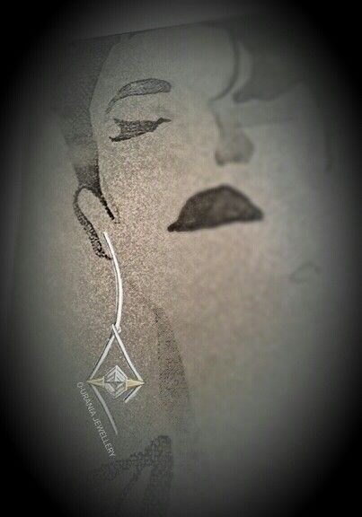 DESIGN OF A SILVER-GOLD EARRING WITH ROCK CRYSTAL