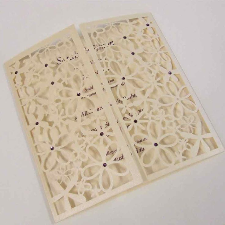 Pretty flower laser cut wedding invitation finished with crystals