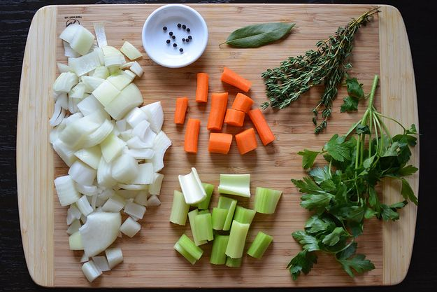 Chop an onion, a stalk or two of celery, and a peeled carrot or two. Grab a bunch of parsley and thyme, a bay leaf, and some peppercorns. | How To Make Turkey Stock, The Most Important Thanksgiving Ingredient