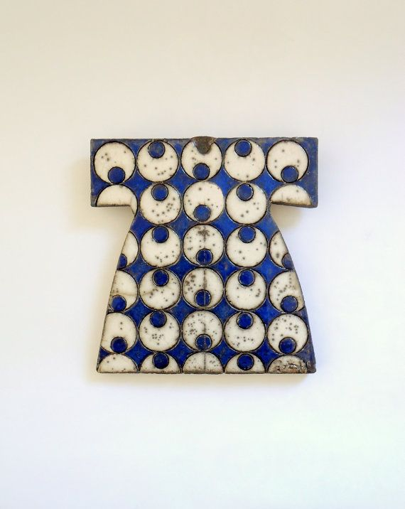 I love the pattern and the colours of this Raku fired cobalt blue ceramic piece