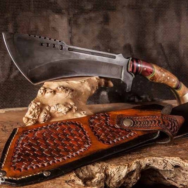 That handle makes it look like it's from the wild west and the blade haves the feel of a .44 and that you should not be at the end of it.
