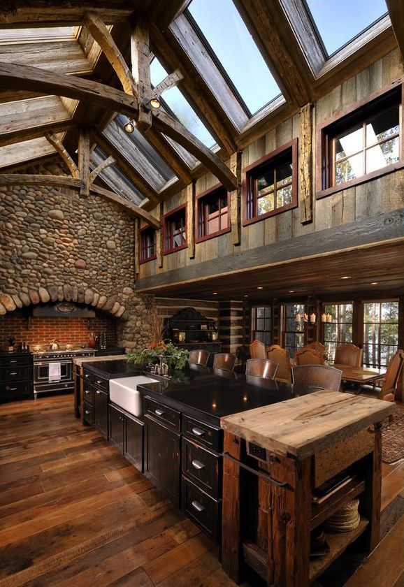 This is absolutely the set-up of the kitchen I want. Larger stones for the fireplace though.