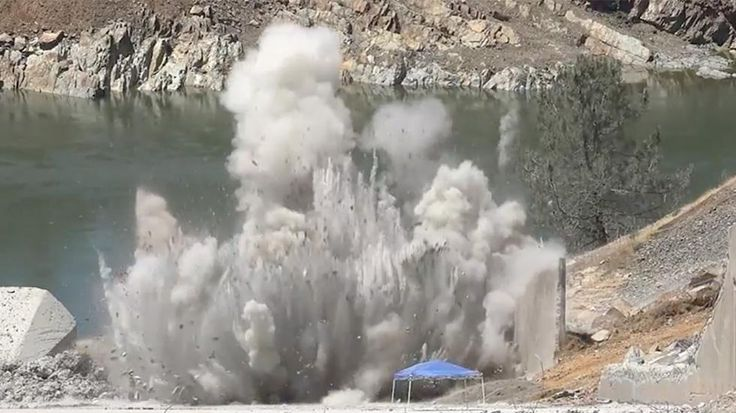 Workers blow up a section of the damaged spillway at California's Oroville Dam as the race to repair it kicks into high gear.