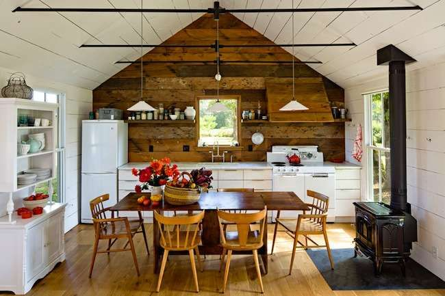 interior designer Jessica Helgerson moved her family to a 540-square-foot cottage of her own design 15 minutes north of Portland, OR. By using mainly reclaimed materials to construct her miniscule maison, and by adding a moss-and-fern green roof, Helgerson completed the project for less than anticipated, and it requires little energy to heat and cool