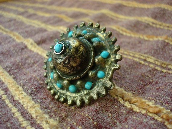 """Antique Afghan ring 1930s. Traditional Afghan alpaca ring. Made of a kind of alloy, similar with silver, called Alpaca or """"bafon"""". The alloy composition are nickel, copper and aluminum. There are natural turquoise stones on the ring. There is also nice, local handwork decoration on it."""