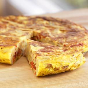 Potato and Roasted Bell Pepper Tortilla. Traditionally enjoyed as a tapa or a lunch dish, the round Spanish egg dish known as a tortilla resembles an Italian frittata. The tortilla is served at room temperature, so it's ideal for entertaining because you can cook it in advance. ♥ Williams-Sonoma