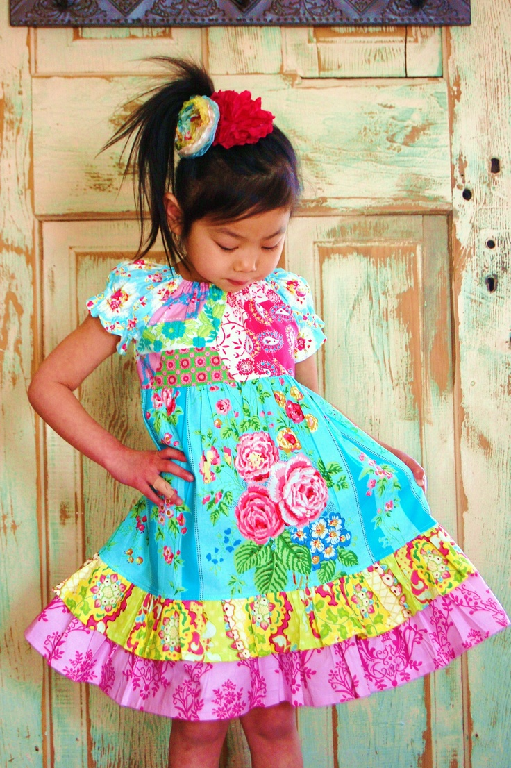 Colourful girls dress  Is this fabric from Jennifer Paginelli (or however her name is spelled?)?