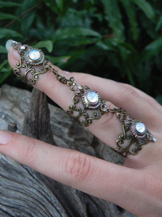 Beautiful! Etsy listing at https://www.etsy.com/listing/207203056/slave-ring-triple-armor-ring-claw-ring
