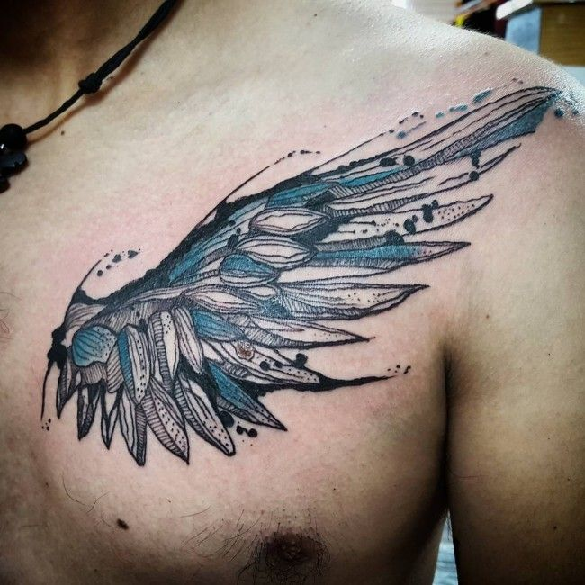 Unusual-designed black-and-blue wing tattoo on chest - Tattoos photos