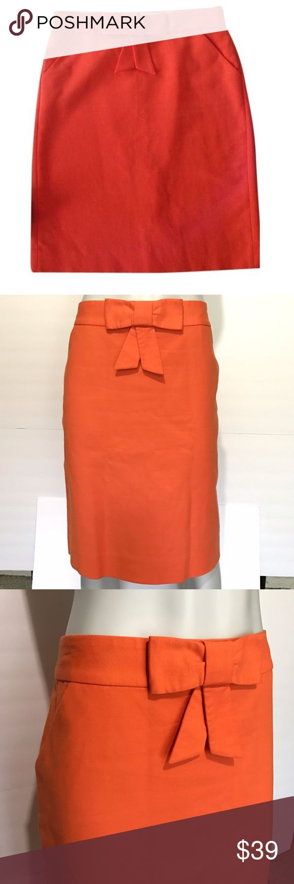 {j. crew} double serge bow pencil skirt Orange pencil skirt with bow on front. Zips up in back. Has two pockets. Stylish, bright skirt for professional work settings. J. Crew Skirts Pencil