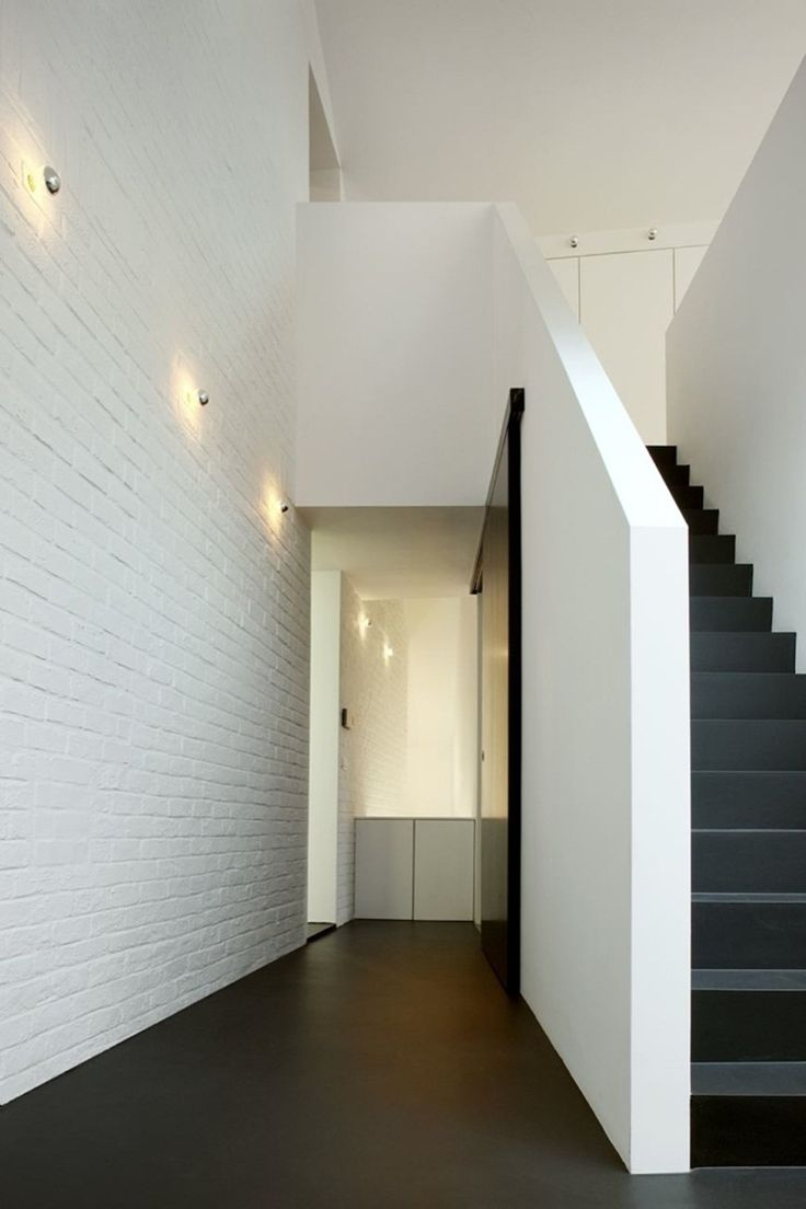 white brick wall + black stairs + clean lines