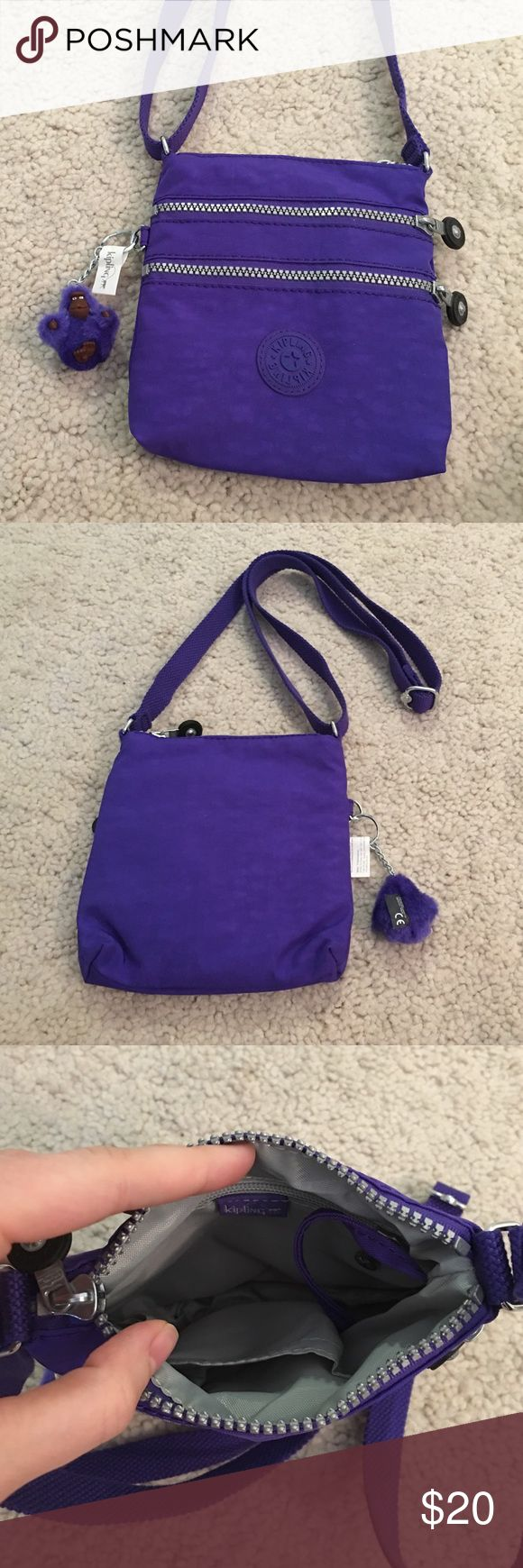 Kipling purple cross body handbag purse This is a purple cross body handbag purse from Kipling in one size fits all s/m/l. This purse is brand new! It does not have the original sales tag, but it does has the Kipling tag still attached to the signature Kipling monkey keychain. This purse measures approx. 7 inches in length by 7.5 inches in height by 0.5 inches in depth. The strap is adjustable. Thanks for looking!!!! Kipling Bags Crossbody Bags