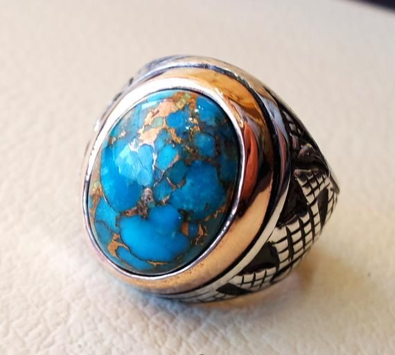 Copper ring with semi precious turquoise gemstone
