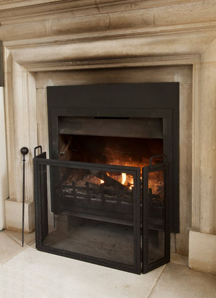 This Folding Firescreen is crafted in wrought iron and is ideal to wrap around the hearth