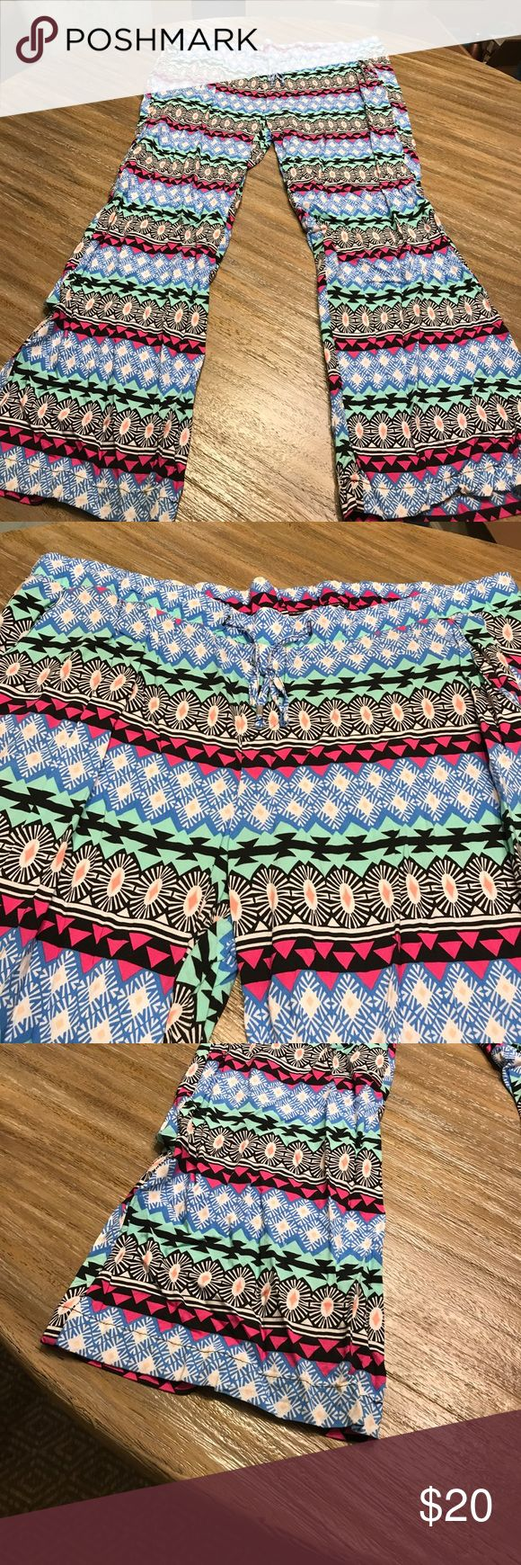 Aztec wide leg pants!! Wide leg aztec printed pants! Has drawstring elastic waist and flowy at bottom! Vibrant colors! Pink, robins egg blue, black and teal!! Old Navy Pants Wide Leg