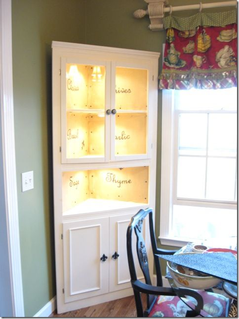 Jackpot! This lady's blog has some amazing project ideas she's posted that she's already done. I really love this lit and repainted corner cabinet.