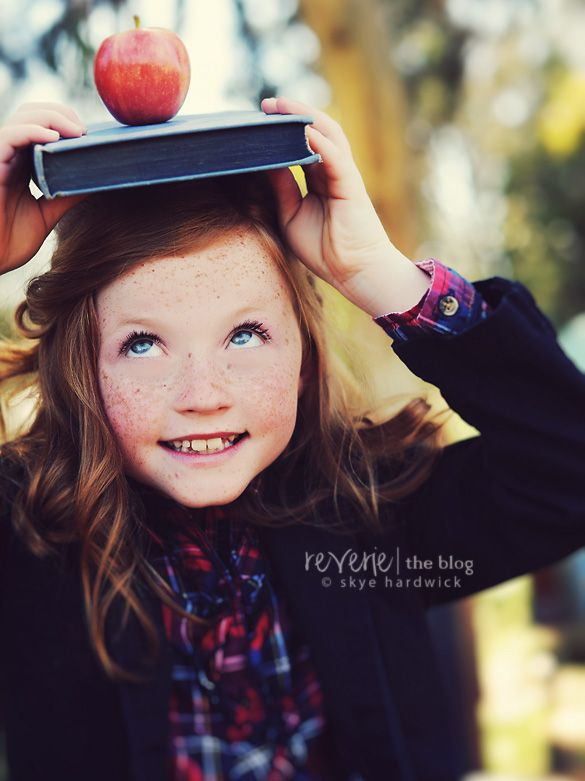 such a darling girl i love books and apples for back to school shoots!  I have been wanting to do this for a few years!  I think it is time now that my oldest is in Kinder -- just need cooler weather to dress for FALL!