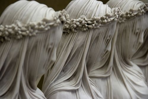 Veiled Vestal Virgin was carved out of marble by Raffaelle Monti in 1847//