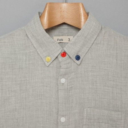 sew 3 colorful buttons on a neutral shirt