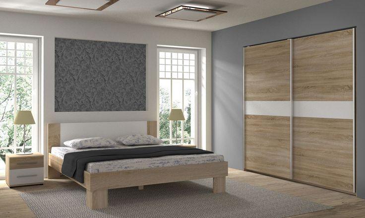 Sypialnia Colonia z przestronną szafą z drzwiami przesuwnymi, łożem sypialnianym dostępnym w wymiarze 160 lub 180 cm szerokości oraz szafkami nocnymi .