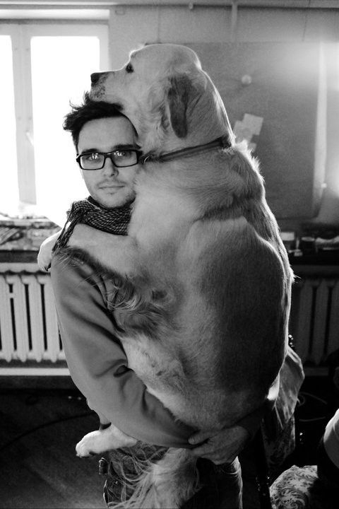 Dog hug.  What a big ol' baby.