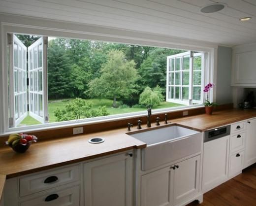 I wouldn't mind washing up so much if it was sunny and I had windows like this to stare out of...