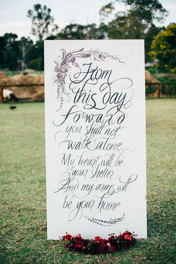 Giant wedding banner with love quote {Facebook and Instagram: The Wedding Scoop}