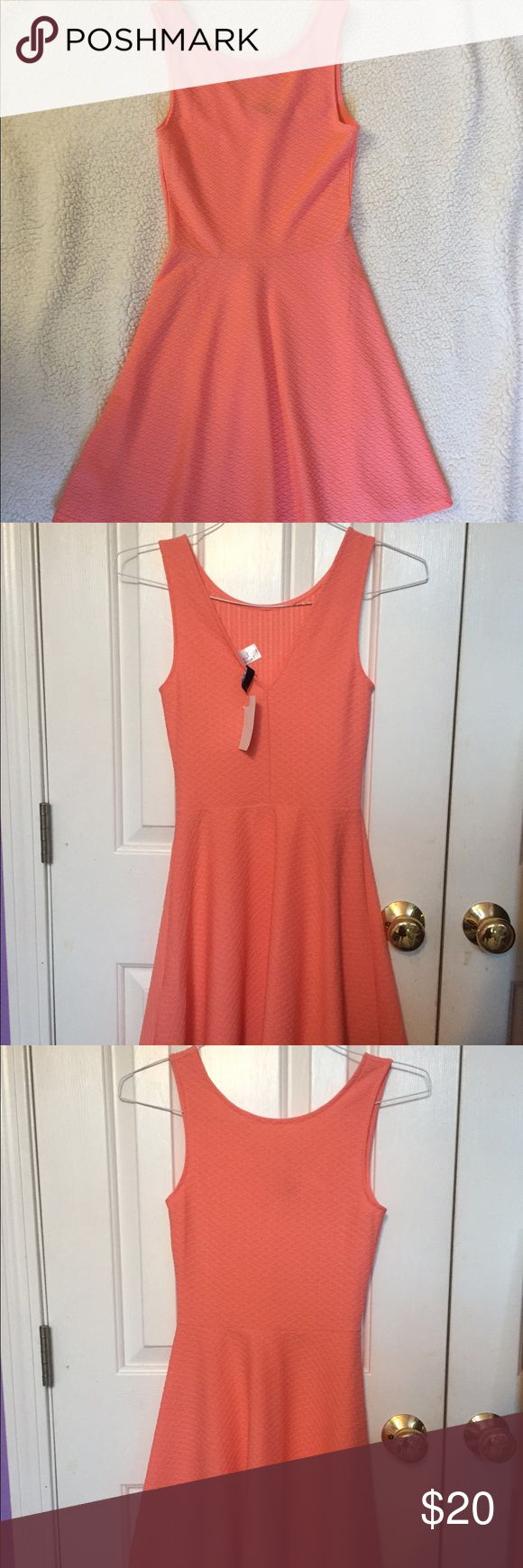 Coral Cocktail Dress This dress is perfect for any summer occasion! Can dress it up or dress it down. Never worn, tags still on it. H&M Dresses