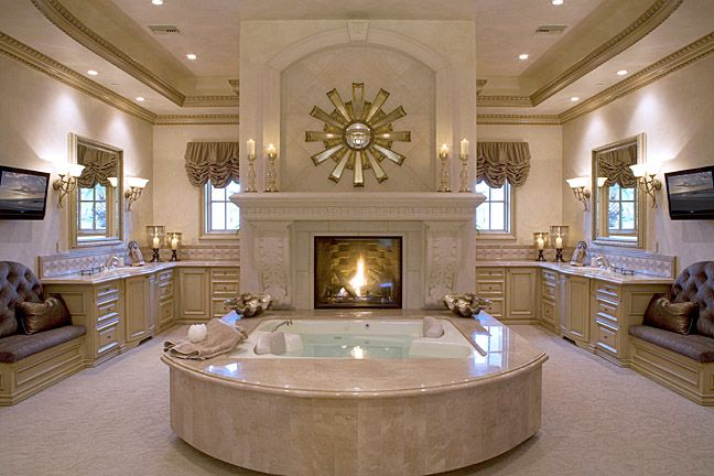 Bathroom with fireplace in front of a two-person tub