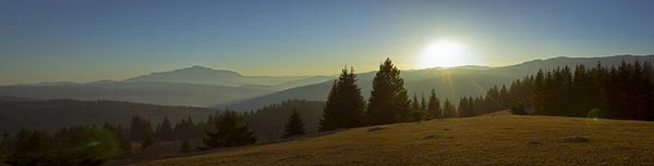 Mountain panorama at sunset with beautiful sun glare. Photo taken in Neamt county – ROMANIA