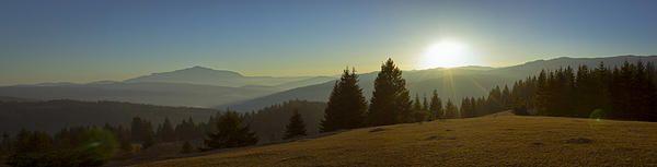 Mountain panorama at sunset with beautiful sun glare. Photo taken in Neamt county – ROMANIA