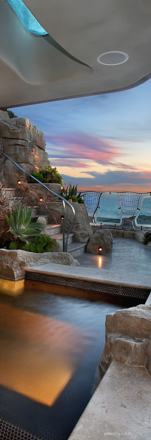 Wow.. One of the most recognizable homes in south Laguna Beach is 31107 Coast Highway, Laguna Beach also known to locals as the Rockhouse.  photo by John Stanaland