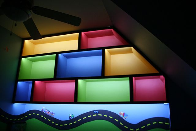 shelving at night - built in shelving painted different colors lit up at night.  Great for small kids bedroom - lots of extra space to store toys.  Love the lighting!  Transportation room  | Flickr - Photo Sharing!