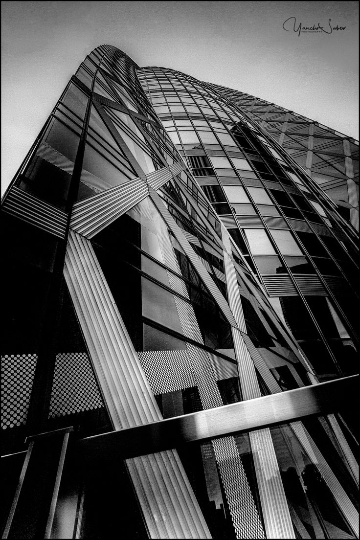"""The Mode Gakuen Cocoon Tower is easily identifiable among other skyscrapers of Nishi-Shinjuku in Tokyo. The building's elliptic shape, wrapped in a criss-cross web of diagonal lines, embodies the """"cocoon"""" concept."""