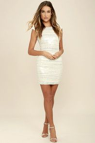 The dance floor and the Feeling Alive Silver and White Sequin Dress are calling our name! Silver sequins are covered by sheer white mesh over a bateau neckline, and sleeveless bodice with cap sleeves. Bodycon skirt. Hidden back zipper with clasp.