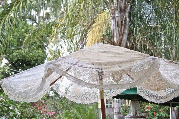 Take the canvas cover off of a patio umbrella, then sew together 3 pieces of lace yardage (look for lace tablecloths to use) and trim with a lace ruffle. ...
