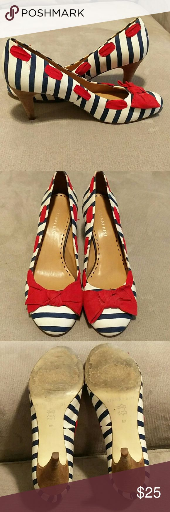 Gianni Bini nautical pumps Adorable little blue and white striped heels with red bow. They are used with signs of wear, but over all in good shape. The white is a little dirty in spots, but still looks white. Gianni Bini Shoes Heels