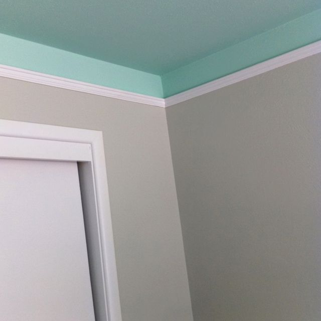 Turquoise ceiling color comes down onto the walls!