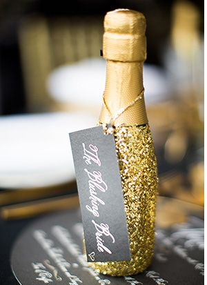 gold glitter champagne bottle favours - Read More on One Fab Day http://onefabday.com/castle-oliver-wedding-by-christina-brosnan/