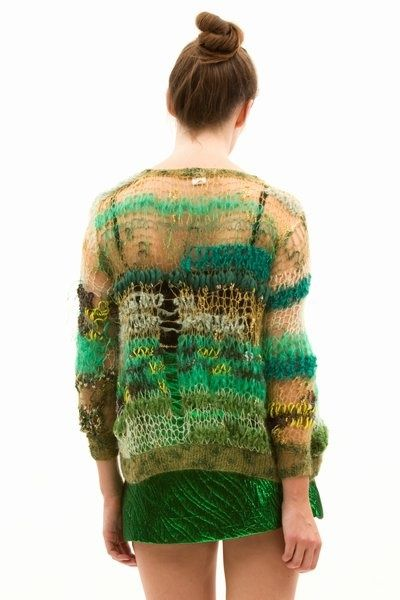 Make a beautiful and unique garment by mixing a wide variety of yarn scraps. The green color palette ties this piece together.