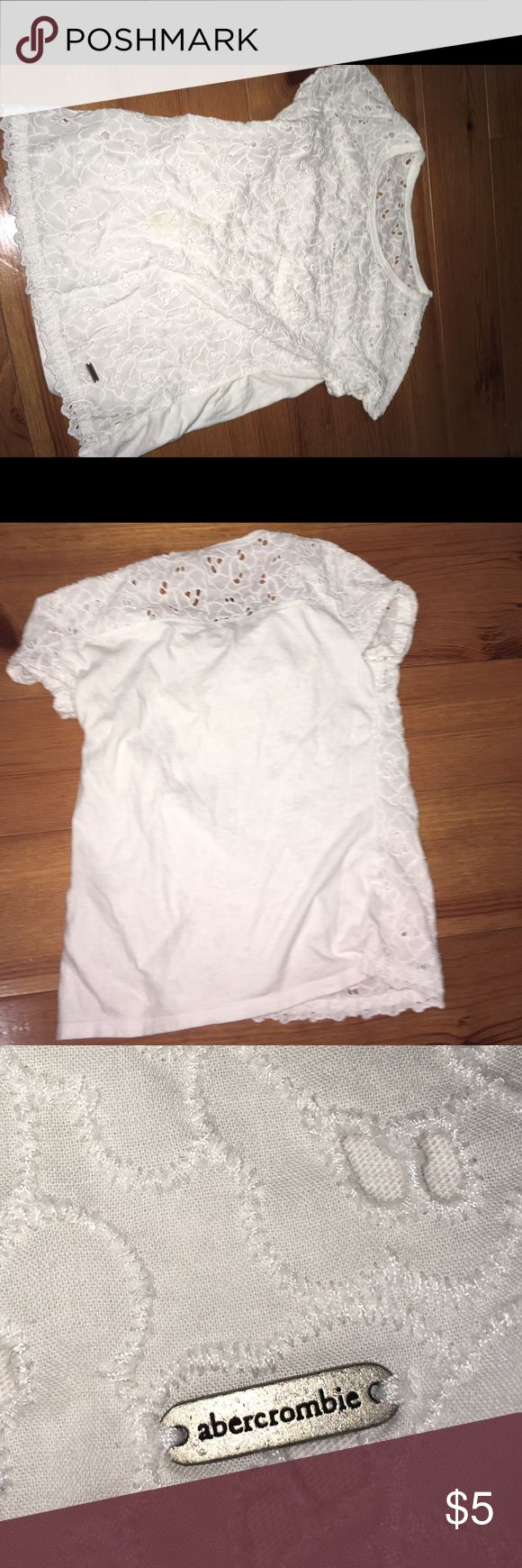 Abercrombie Kids White Lace Shirt White Lace Shirt// The lace/crochet pattern is all along the front and only the top portion of the back. There is a medal tag/plate with Abercrombie spelled on it on the front and a functioning pocket! **(I also have this shirt in a small. Siblings can match! On the small size shirt the metal tag/plate is hanging as seen in pic 7)  Have any questions? Comment below! Abercombie Kids Shirts & Tops Tees - Short Sleeve